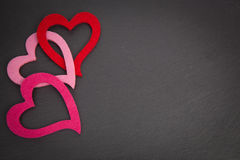 Chalkboard with red and pink hearts Royalty Free Stock Photos