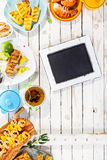 Chalkboard on Rustic Table with Grilled Dishes Stock Images
