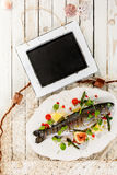 Chalkboard on Rustic Table with Whole Grilled Fish Stock Images