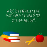 Chalkboard at school. Chalkboard background with chlak alphabet Royalty Free Stock Photo