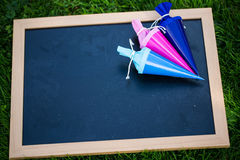 Chalkboard with school books lying in the meadow Stock Photo