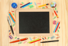 Chalkboard with school office supplies Stock Photo