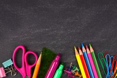 Chalkboard with school supplies bottom border Stock Photography