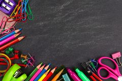 Chalkboard with school supplies corner border Stock Photography