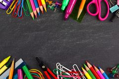 Chalkboard with school supplies frame Stock Photos