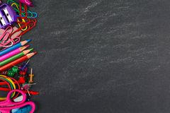 Chalkboard with school supplies side border. School supplies side border on a chalkboard background Stock Images