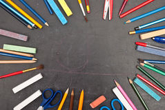 Chalkboard with school tools Stock Photography