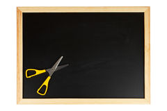 Chalkboard with scissors. A empty black chalkboard with yellow scissors. Path included Stock Photos
