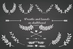 Chalkboard set with laurels, arrows and hearts Stock Image