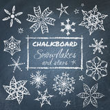 Chalkboard set of snowflakes Stock Image
