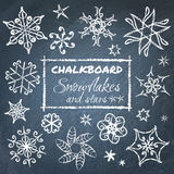 Chalkboard set of snowflakes Stock Images