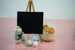 Chalkboard with funny chicks on pink background. Chalkboard with sheep on pink background, copy space royalty free stock images