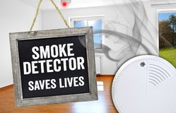 Chalkboard with smoke detector saves lives stock image