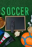 Chalkboard, snacks and football on artificial grass. Overhead view of chalkboard, snacks and football on artificial grass stock images