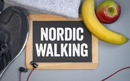 Chalkboard with sport shoes, headphones and fruits Nordic Walking stock image