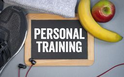 Chalkboard with sport shoes and personal training royalty free stock image