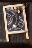 Chalkboard with sugar and painted coffee Stock Photo