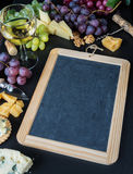 Chalkboard surrounded by different food Stock Photography