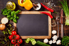 Chalkboard Surrounded by Herbs and Vegetables Stock Image