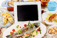 Chalkboard on Table with Grilled Seafood Meal Royalty Free Stock Photo