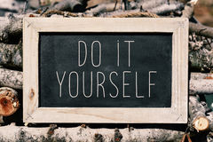 Chalkboard with the text do it yourself Stock Image