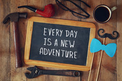 Chalkboard with the text everyday is a new adventure Royalty Free Stock Images