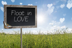 Chalkboard with text Float in LOVE Royalty Free Stock Photos