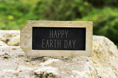 Chalkboard with the text happy earth day stock photography