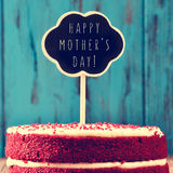 Chalkboard with the text happy mothers day on a cake Stock Image