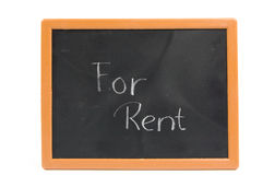 Chalkboard with the text for rent Stock Images