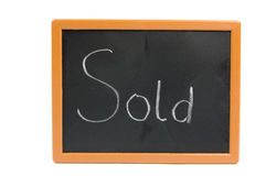 Chalkboard with the text sold Stock Photo