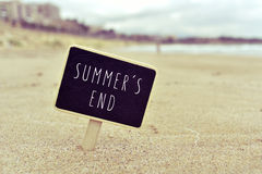 Chalkboard with the text summers end in a beach Royalty Free Stock Photos
