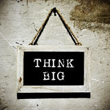 Chalkboard with the text think big, vignetted Royalty Free Stock Photo