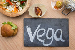 Chalkboard with text vega and vegetarian food Stock Image