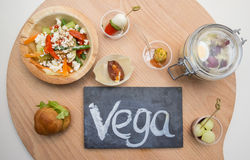Chalkboard with text vega and vegetarian food Royalty Free Stock Photography