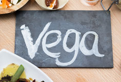 Chalkboard with text vega and vegetarian food Stock Photography