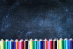Chalkboard Texture Background with Colored Pencils Royalty Free Stock Photos