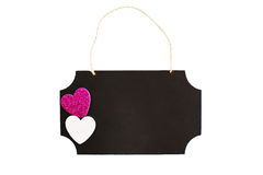 Chalkboard with twine hanger and glitter hearts Stock Photo