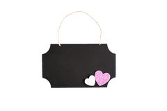 Chalkboard with twine hanger and glitter hearts Stock Image
