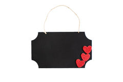 Chalkboard with twine hanger and glitter hearts Royalty Free Stock Photo