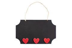 Chalkboard with twine hanger and glitter hearts Royalty Free Stock Image