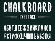 Chalkboard typeface, modern font written on the board with charcoal Russian alphabet, cyrillic. Modern font western letters in chalk board style, uppercase and Vector Illustration