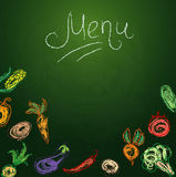 Chalkboard with vegetables for restaurant menu Stock Photo