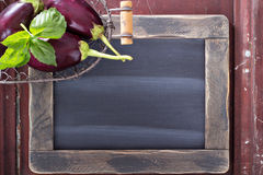 Chalkboard with vegetables on the side Royalty Free Stock Images