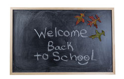 Chalkboard welcoming the student back to school in the autumn se Royalty Free Stock Images