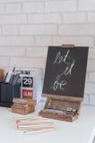 Chalkboard on white desk Royalty Free Stock Photography