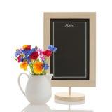 Chalkboard and wildflowers Stock Photo