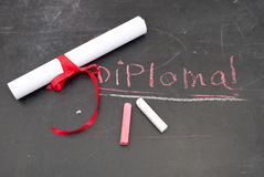 Chalkboard With A Diploma Stock Photos