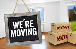 Free Chalkboard With Boxes In A Room And Were Moving Stock Image - 134219881