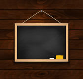 Chalkboard on wood background Royalty Free Stock Images